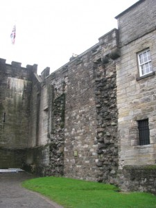 Scars of removed James IV flanking tower in curtain wall